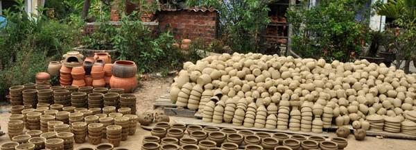 Photo by http://vietnamdiscoveries.com/en/hoian/place/life/thanh-ha-pottery-village-145.html